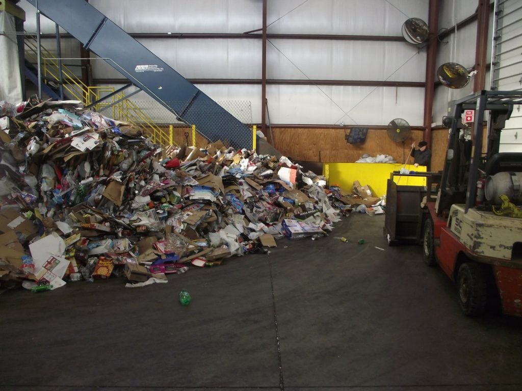 MRF tipping floor. Aspirational recycling