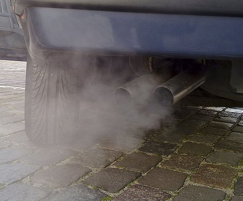 car exhaust. hidden costs of not going green