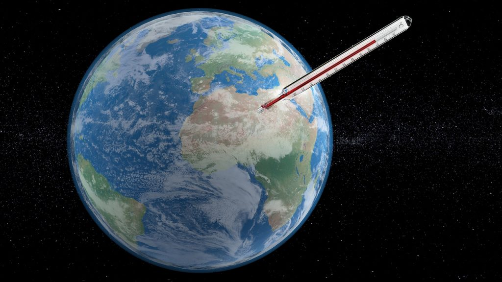 Earth with thermometer. climate change scare