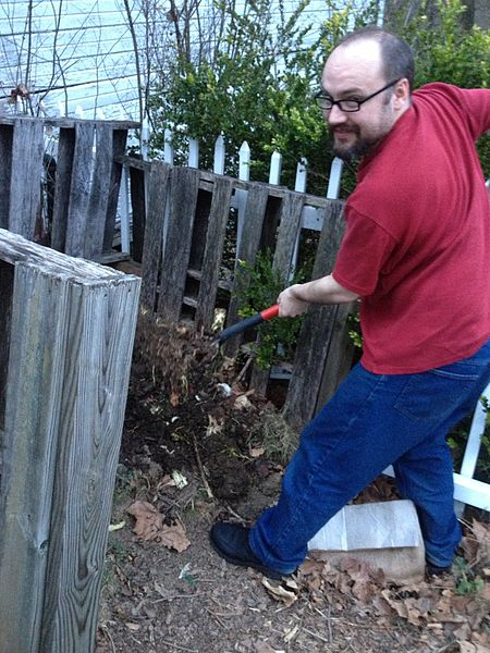 turning a compost pile. sustainable living