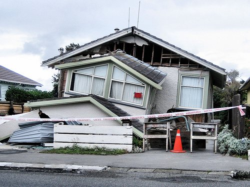 Earthquake-damaged house. environmental degradation