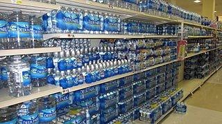 bottled water in supermarket. hidden costs of not going green