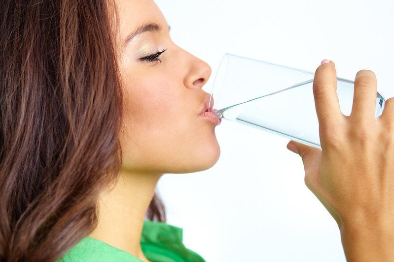 woman drinking water. health benefits