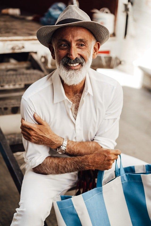man with reusable cloth shopping bag