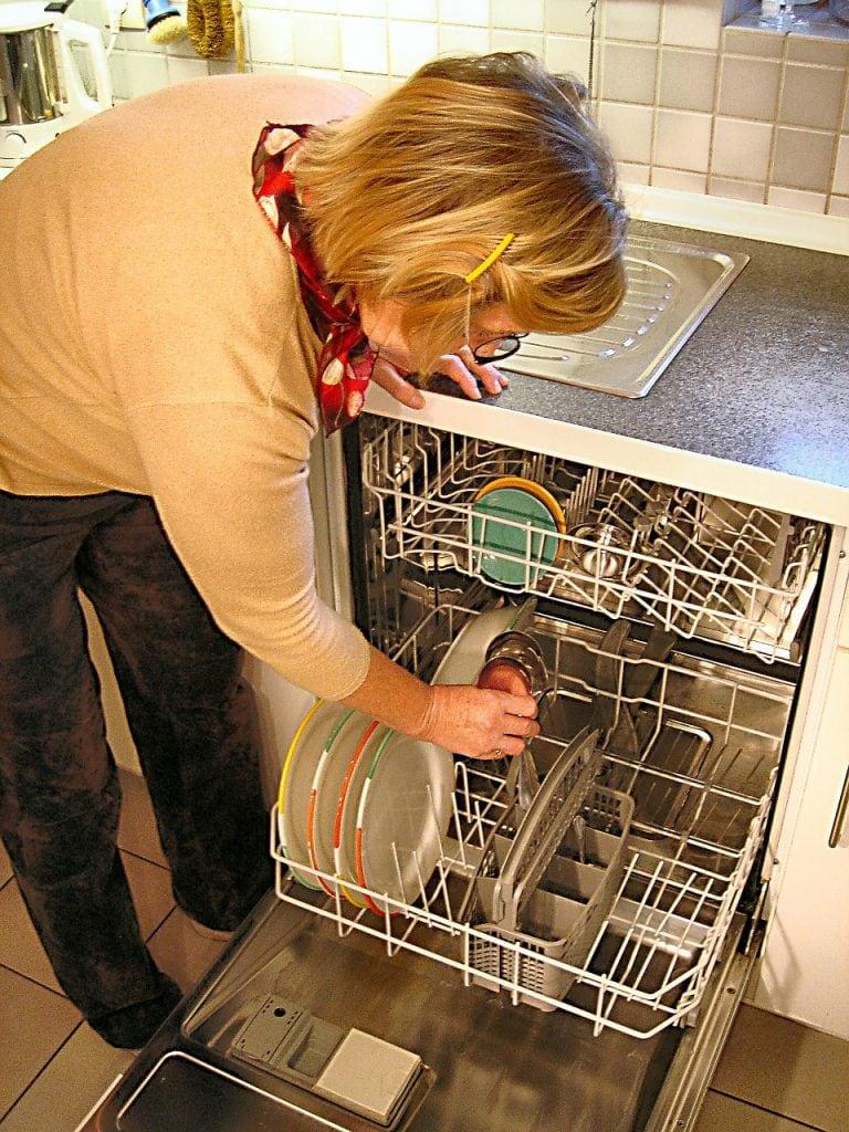Loading a dishwasher. dishwasher vs hand washing