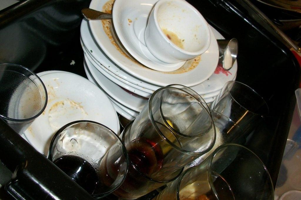 dirty dishes. dishwasher vs hand washing