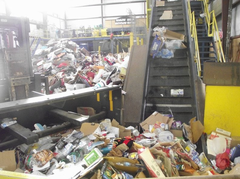 recycling tipping floor and conveyor. recycling myths