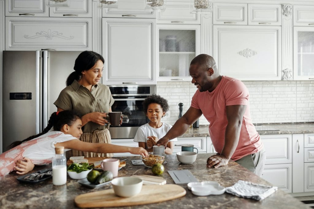 Family in  kitchen. Sustainable kitchen