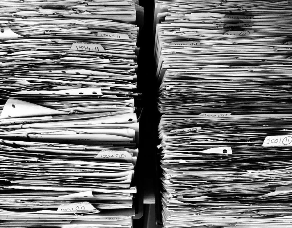 Piles of paper. use less paper