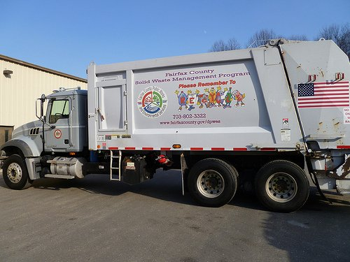 Trash and recycling truck. Extended producer responsibility