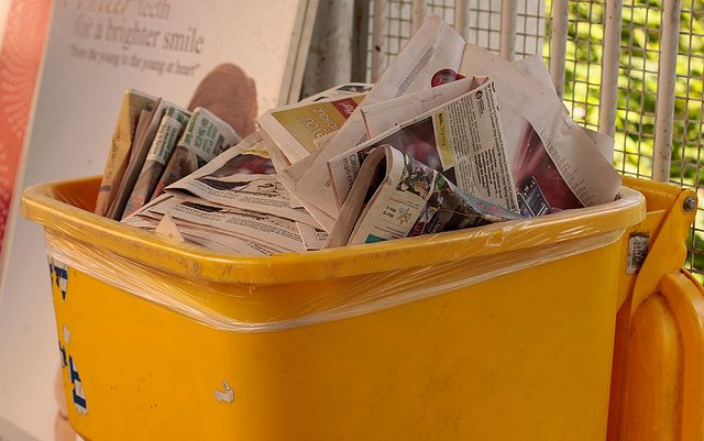 Wastebasket with newspapers. Use less paper