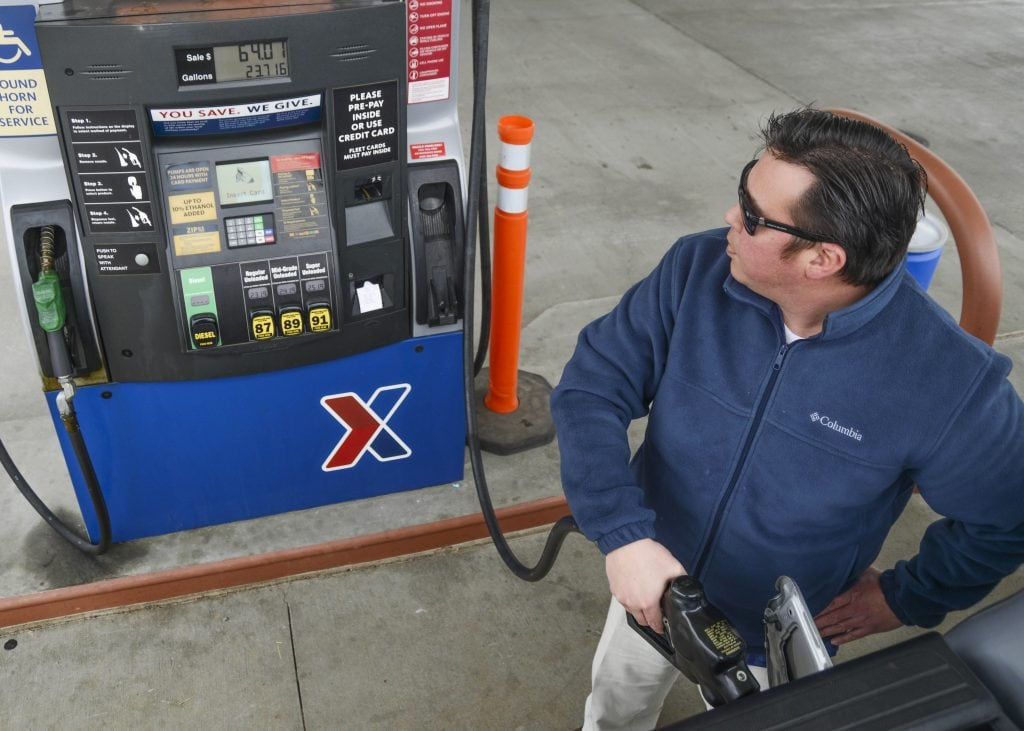 Pumping gas. Driving tips to use less gas