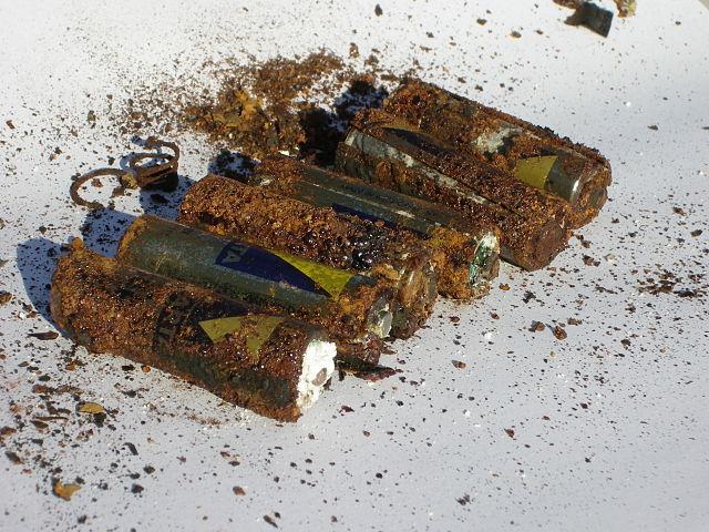 corroded batteries. hazardous household wastes