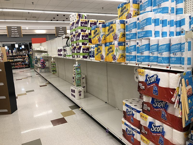 partly bare shelves from hoarding. grocery shopping habits