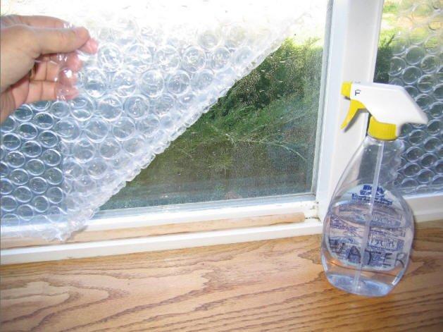bubble wrap on a window. insulating window treatments