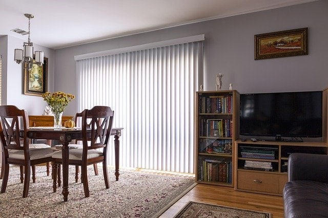 room with vertical blinds--energy-efficient window treatments