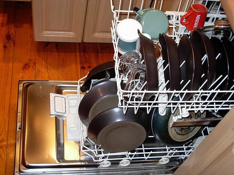 Dishwasher, loaded with dishes. dishwasher vs hand washing